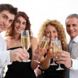 Group of friends cheering with glasses of champagne — Stock Photo