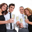 Group of friends cheering with glasses of champagne — Stock Photo #5699007