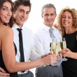 Group of friends cheering with glasses of champagne — Stock Photo #5699009