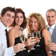Group of friends cheering with glasses of champagne — Stock Photo #5699039