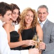 Group of friends cheering with glasses of champagne — Stock Photo #5699043