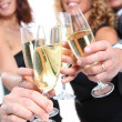 Group of friends cheering with glasses of champagne — Stock Photo #5699045