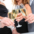 Stock Photo: Group of friends cheering with glasses of champagne
