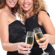 Girlfriends cheering with glasses of champagne — Stock Photo #5699052