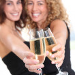 Girlfriends cheering with glasses of champagne — Stock Photo
