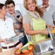 Group of friends prepraing dinner — Stock Photo
