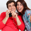 Couple having fun listening to music player — Stock Photo #5699242