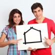 Stock Photo: Couple holding whiteboard