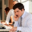Businessman in the office talking on the phone — Stock Photo #5699391