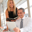 Manager and assistant working in the office — Stock Photo #5699430