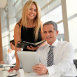 Manager and assistant working in the office — Stock Photo #5699431