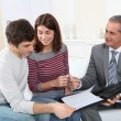 Young couple sigining renting contract — Stock Photo #5699782