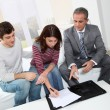 Young couple sigining renting contract — Stock Photo #5699783