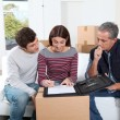 Young couple signing contract for home moving - Zdjęcie stockowe