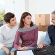 Young couple signing contract for home moving - Photo