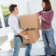 Young couple moving in new house — Stock fotografie