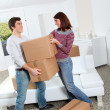 Young couple moving in new house — Stock Photo #5699798