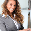 Portrait of smiling businesswoman — Stock Photo #5699819