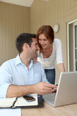 Self-employed man working at home with wife — Stock Photo