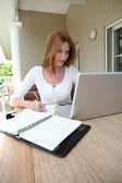 Woman working at home on laptop computer — Photo