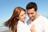 Happy married couple at the beach — Stock Photo