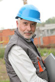 Portrait of construction manager on building site — Stock Photo