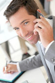 Businessman talking on the phone — Stock Photo