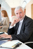 Senior businessman working on laptop computer — Stock Photo