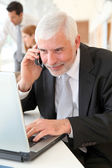 Senior businessman at work — Stock Photo