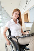 Portrait of beautiful businesswoman standing in hall — Stock Photo