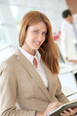 Beautiful woman in office with agenda — Stock Photo