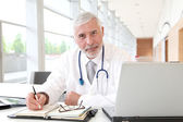 Portrait of senior doctor in office — Stock Photo