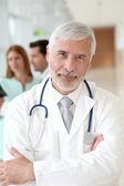 Portrait of smiling senior doctor — Stock Photo