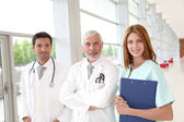 Portrait of medical team standing in hospital hall — Stock Photo