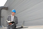 Businessman checking industrial installation — Stock Photo