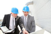 Business partners working on industrial site — Stock Photo
