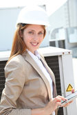 Portrait of businesswoman wearing security helmet — Stock Photo