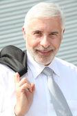 Portrait of senior businessman standing outdoors — Stock Photo