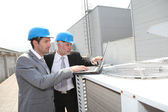 Businessmen on industrial site — Stock Photo