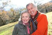 Senior couple in countryside — Stock Photo