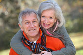 Senior couple in countryside — Stock Photo
