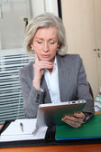 Senior office worker in office with electronic pad — Stock Photo
