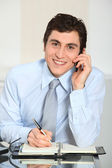 Portrait of smiling businessman on the phone — Stok fotoğraf