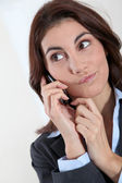 Businesswoman on the phone with preoccupied look — Stock Photo