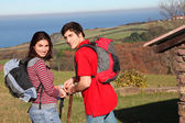Couple hiking in countryside on beautiful fall day — Stock Photo