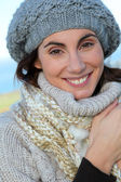Portrait of beautiful smiling woman in winter — Stock Photo
