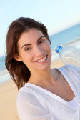 Portrait of beautiful smiling woman at the beach — Stock Photo