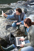 Biologists testing water of natural river — Stock Photo