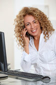 Portrait of businesswoman with mobilephone — Stock Photo
