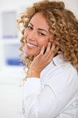 Beautiful woman talking on the phone — Stock Photo